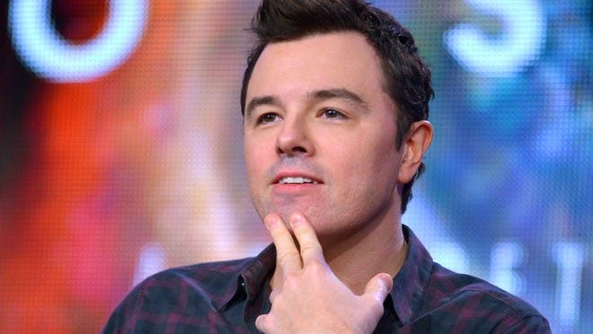 """Executive producer and one-time Oscar host Seth MacFarlane ponders a question during a panel interview for his show """"Cosmos."""""""
