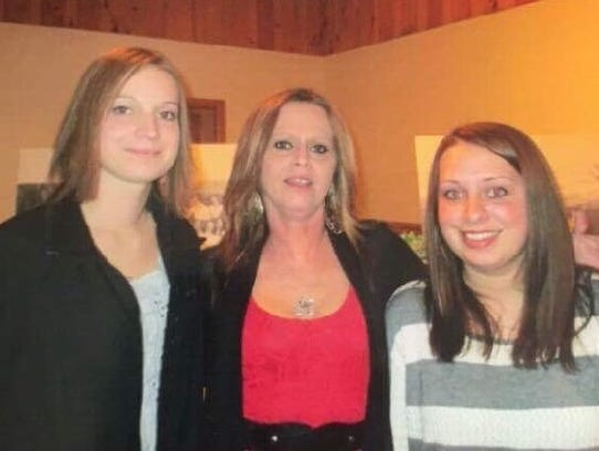 Suzette Langlois, center, and her daughters Nicole