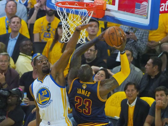 Golden State Warriors forward Kevin Durant (35) defends a shot against Cleveland Cavaliers forward LeBron James (23) in the NBA Finals.