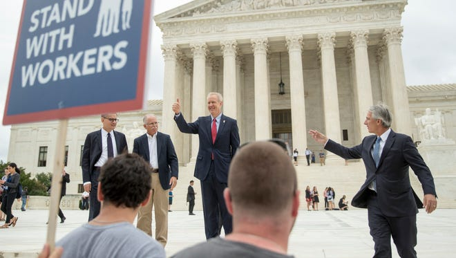 From left, Liberty Justice Center's Director of Litigation Jacob Huebert, Illinois Gov. Bruce Rauner, Liberty Justice Center founder and chairman John Tillman, and plaintiff Mark Janus walk out of the the Supreme Court after the court rules in a setback for organized labor that states can't force government workers to pay union fees in Washington, June 27, 2018.