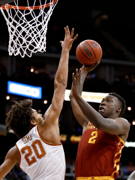 Iowa State's Cameron Lard shoots over Texas' Jericho Sims (20) during the first half of an NCAA college basketball game in the Big 12 men's tournament Wednesday, March 7, 2018, in Kansas City, Mo. (AP Photo/Charlie Riedel)