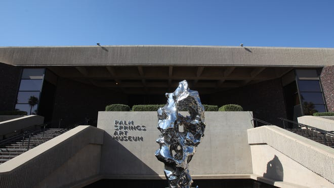 The exterior of the Palm Springs Art Museum, 101 Museum Drive, Palm Springs, photographed on November 15, 2013 with a sculpture by Zhan Wang.