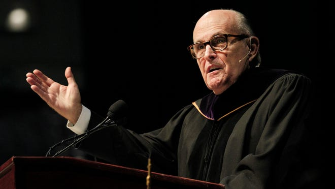 Former New York City Mayor Rudolph Giuliani delivers the commencement speech to the 2015 graduating class from St. John FIsher College at the Blue Cross Arena.