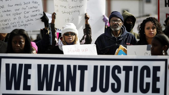 Shelia Reid (center, wearing hat) walks with other protesters in Bridgeton in February. Her son, Jerame Reid, was fatally shot by city police during a traffic stop Dec. 30. A grand jury decided not to indict the officers, officials announced Thursday.