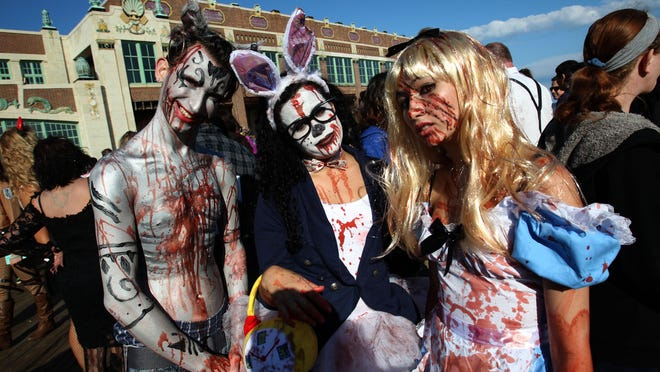 Participants of the Zombie Walk in Asbury Park make their way along the boardwalk last year. A new zombie walk is scheduled for Oct. 2 in Boonton.