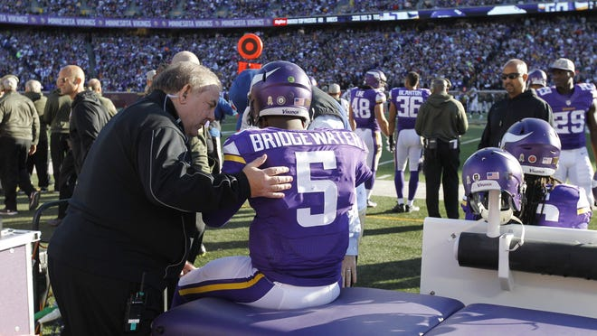 Minnesota Vikings quarterback Teddy Bridgewater (5) is examined during the second half of an NFL football game against the St. Louis Rams, Sunday.