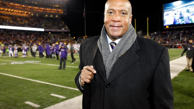 FILE - In this Dec. 27, 2015, file photo, Minnesota Vikings chief operating officer Kevin Warren poses for a photo before an NFL football game against the New York Giants, in Minneapolis. Kevin Warren, the highest-ranking black executive on the business side of an NFL team, worked his way through the industry to be named chief operating officer of the Minnesota Vikings last year.(AP Photo/Ann Heisenfelt, File)