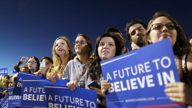 Supporters stand outside a campaign rally in Arizona for presidential candidate Sen. Bernie Sanders.