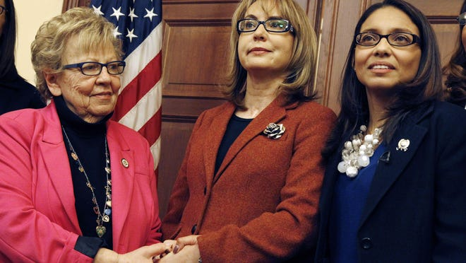 Former Rep. Gabrielle Giffords (center) is joined by Assemblywoman Gabriela Mosquera (right) and state Sen. Loretta Weinberg after a meeting Wednesday in Trenton.