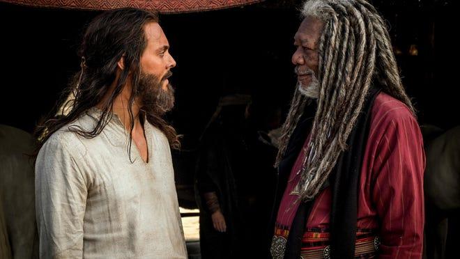 "Jack Huston as Judah Ben-Hur, left, and Morgan Freeman as Ilderim are seen in ""Ben-Hur."""
