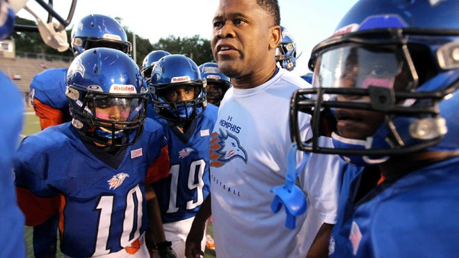 KIPP head coach Tim Thompson fires up his team for a game in 2015.  (Nikki Boertman/The Commercial Appeal)