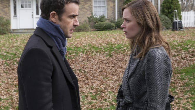 Justin Theroux, left, and Emily Blunt appear in a scene from The Girl on the Train.""