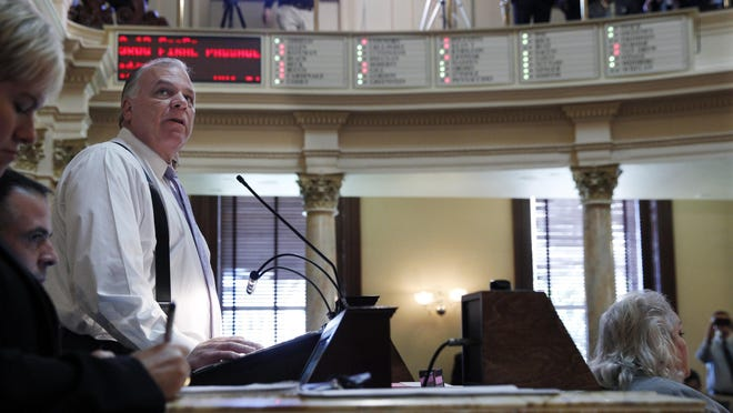 State Senate President Steve Sweeney watches as the senate passes a tax-increase bill Friday, Oct. 7, 2016, in Trenton, N.J.