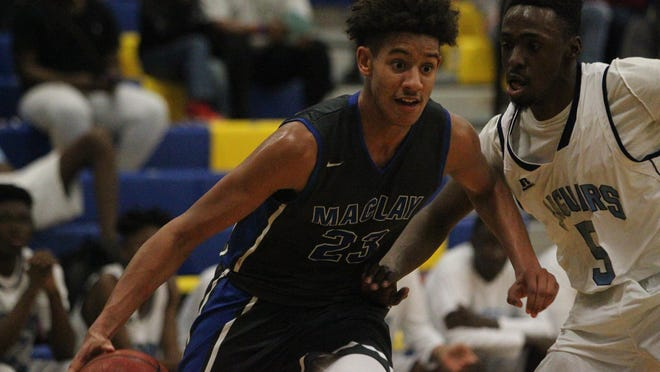 Maclay sophomore Zim Nwokeji drives to the basket against East Gadsden during Monday's MLK Inspire Classic at Rickards. Nwokeji had 22 points and 13 rebounds in a 41-39 win.