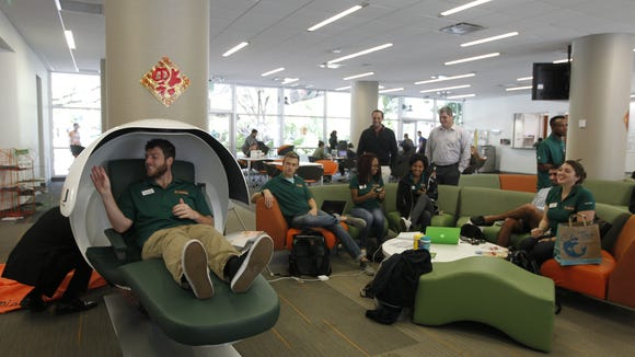 Students try out napping pods at the University of Miami. (Courtesy of the University of Miami)