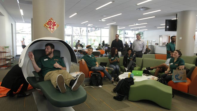 Students try out napping pods at the University of Miami.
