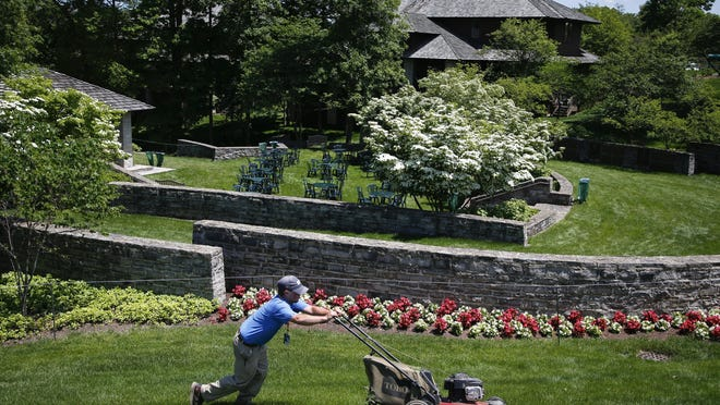 A groundskeeper mows near the clubhouse during a practice round of the Memorial Tournament in 2019 at Muirfield Village Golf Club. The course will host the PGA Tour's Workday event from July 9-12 and the Memorial Tournament from July 16-19.