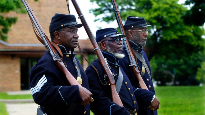 Members from the 29th Infantry Regiment Company F Wisconsin African American Civic War Troop march in the 48th Annual Juneteenth parade on Martin Luther King Drive.