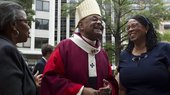 Washington, D.C., Archbishop Wilton Gregory greets churchgoers at St. Mathews Cathedral in October 2019 after the annual Red Mass in Washington. Pope Francis on Sunday named 13 new cardinals, including Gregory, who would become the first Black U.S. prelate to earn the coveted red hat.