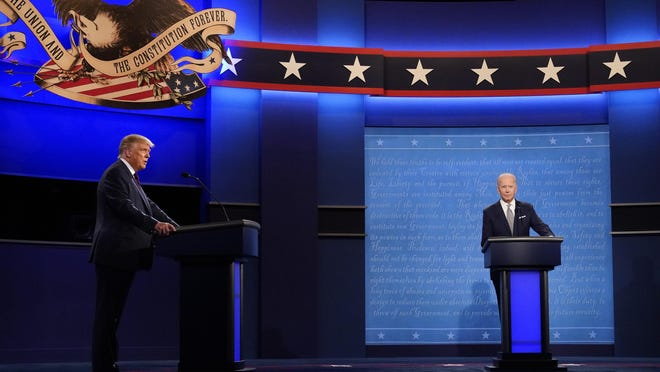 President Donald Trump, left, and Democratic presidential candidate former Vice President Joe Biden during the first presidential debate Tuesday, Sept. 29, 2020, at Case Western University and Cleveland Clinic, in Cleveland, Ohio.
