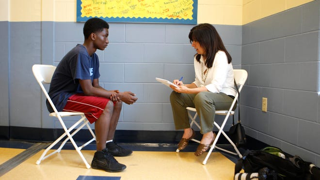 Krista Ramsey interviews Tony Hill for the Turning 14 project. At age 10 Tony and his six sibling were removed from the custody of his mother, and he now lives with his grandmother. He hasn't seen his siblings since.    The Enquirer/Cara Owsley