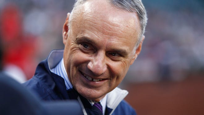 MLB Commissioner Rob Manfred stands on the field before a game between the Los Angeles Angels and Seattle Mariners at Safeco Field.