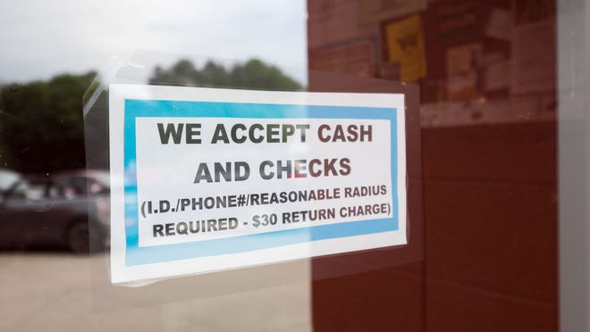 Hinders' restaurant accepts only cash and checks, not credit cards, as this sign on the door tells patrons. She operated the restaurant for nearly 40 years.