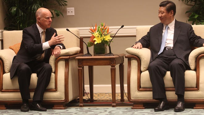 California Gov. Jerry Brown and Chinese President Xi Jinping meet at the Hyatt Regency Indian Wells Resort and Spa on June 8, 2013.