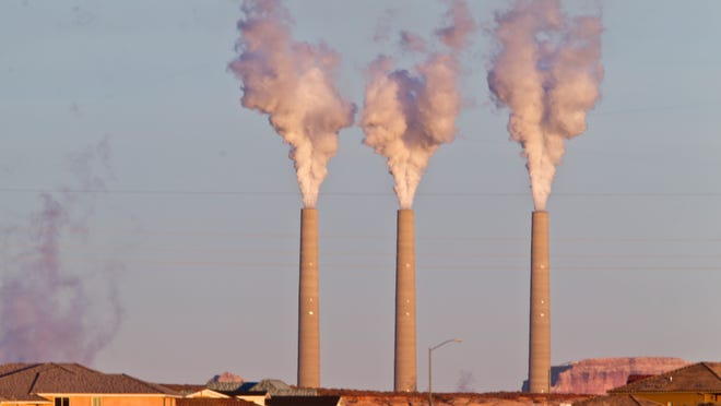 Evaporated water leaves the top of the stacks of the Navajo Generating Station in Page on Jan. 7, 2013.