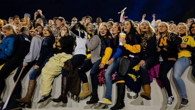 The Port Huron Northern student section cheers during the big game against rival Port Huron Big Reds Friday at Memorial Stadium.