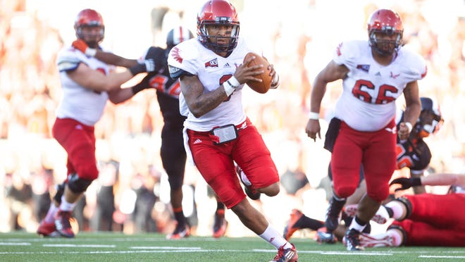 Eastern Washington Eagles quarterback Vernon Adams (3) heads toward the end zone for a touchdown against the Oregon State Beavers on Aug. 31, 2013, in Corvallis.