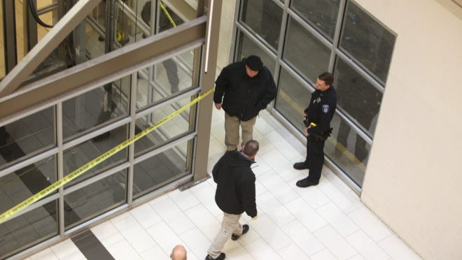 Clarkstown Police investigate near the elevator at the parking garage level where a person landed after falling from the fourth floor of the Palisades Center Mall in West Nyack March 5, 2015.