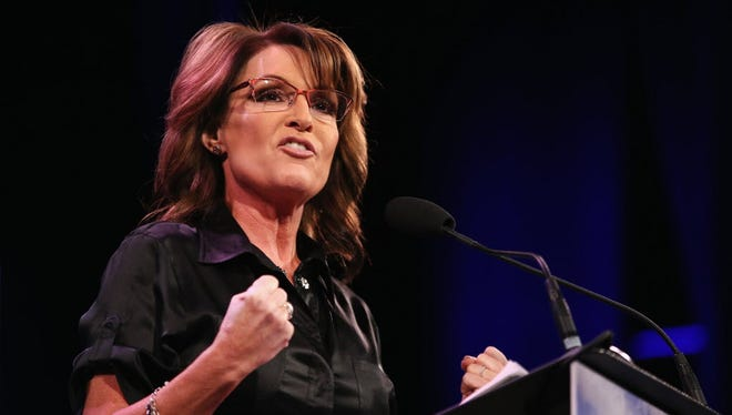 Former Alaska Gov. Sarah Palin speaks to guests at the Iowa Freedom Summit on January 24, 2015 in Des Moines, Iowa. She hinted at interest in running for the White House in 2016.