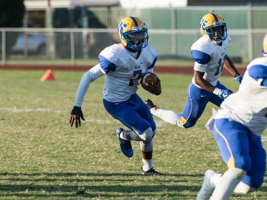 Wi-Hi's LeQuann Petit (7) runs the ball during a game