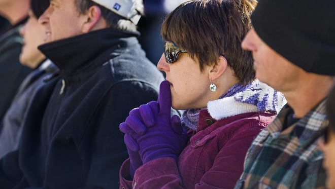 Amanda Marsh, the widow of firefighter Eric Marsh, listens Tuesday during the dedication ceremony for the Granite Mountain Hotshots Memorial State Park south of Yarnell.
