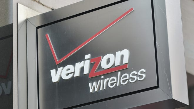 A Verizon sign is seen above a store front.