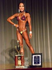 Bikini international overall champion Rhea Macaluso displays her hardware at the 2015 Michelob Ultra Guam National Fitness Championships and International Invitational at the LeoPalace Resort ballroom on Saturday, Sept. 26, 2015.