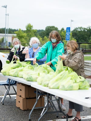 Grafton Food Bank volunteers help distribute fresh produce during the pandemic to meet the needs of families.