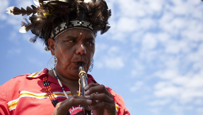 Bill Crouse from Salamanca, Cattaraugus County, tests out a Native American flute during Ganondagan's Dance and Music Festival in Victor on Saturday, July 26, 2014.