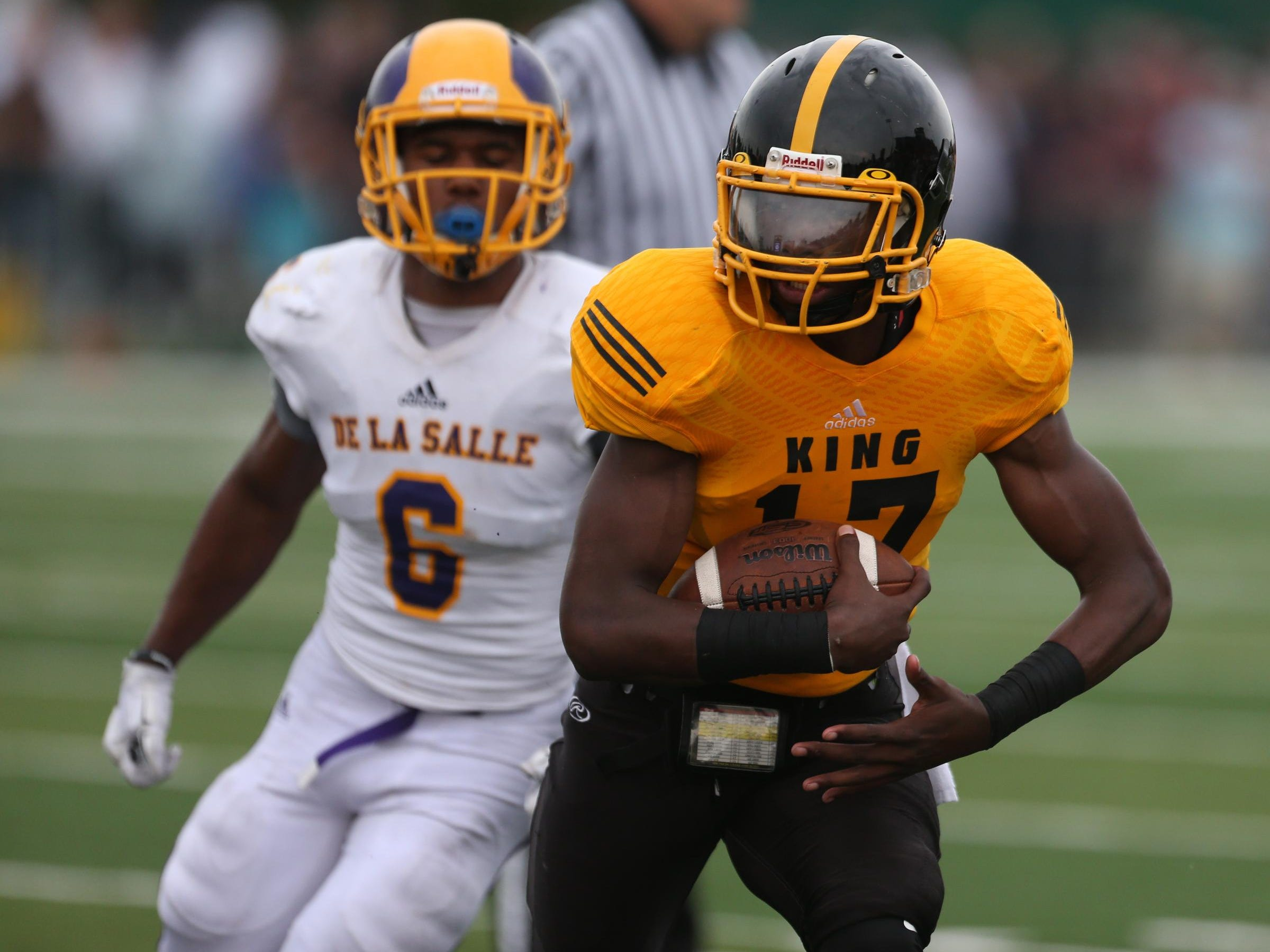 Detroit Martin Luther King high schools Martinez Adams Calloway runs by Warren De La Salle high schools Kevin Lee for a touchdown during second half action of the Prep Kickoff Classic on Saturday, August 29, 2015 at Wayne States Tom Adams Field in Detroit Michigan.