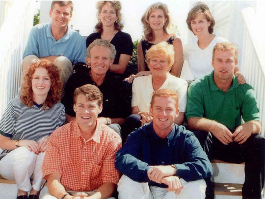 Cowboys coach, front right, and his parents and siblings.