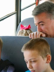 Colorado Sen. Cory Gardner watches as students in rural Eastern Colorado use their new Google-issued Chromebooks to work on a Wi-Fi enabled school bus in April 2017. Gardner, an ardent defender of states' rights, says he's secured a promise from President Trump to leave Colorado's legal marijuana industry alone. Colorado voters who approved legalizing cannabis also mandated that millions of dollars in marijuana taxes help fund construction in rural school districts.