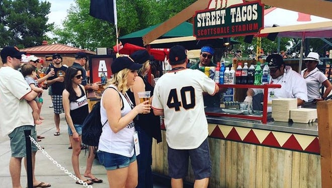 Fans buy street tacos and snacks at a spring training game.