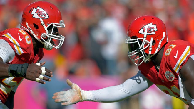 The Chiefs linebacking duo of Justin Houston, left, and Tamba Hali started the season strong.