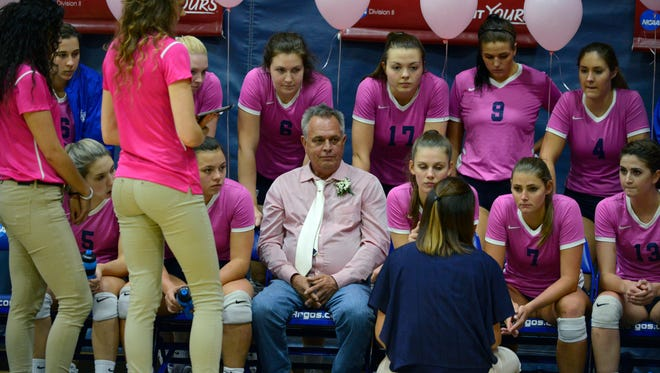 Honorary coach Scott Gauvin sits on the the bench with the UWF volleyball team Saturday, October 21, 2017 during the Pack it Pink game against West Alabama at the UWF Field House. Gauvin's wife Patricia passed away from breast cancer in 2015.