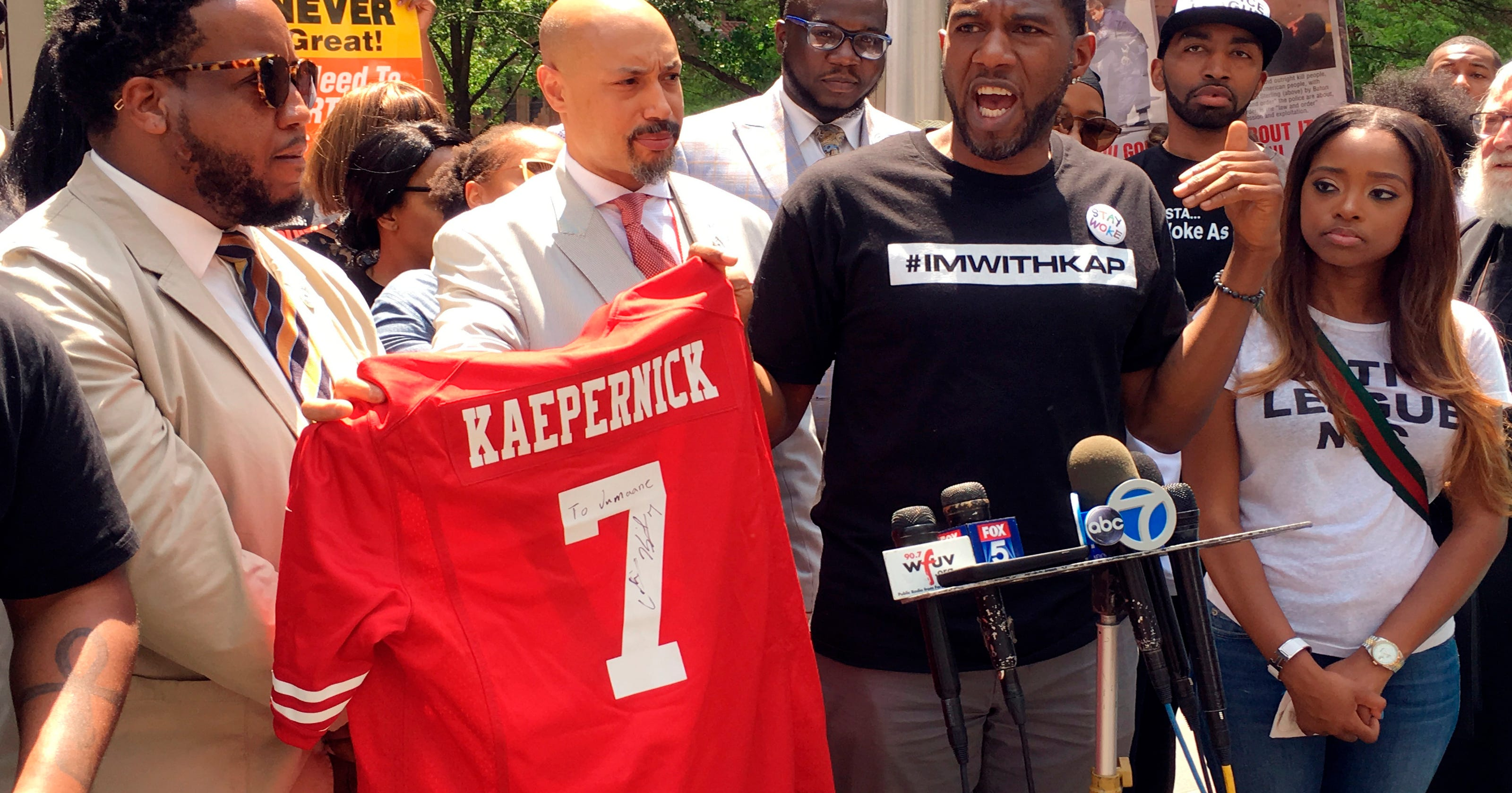 9f4dfeba Civils rights activists rally outside of NFL headquarters