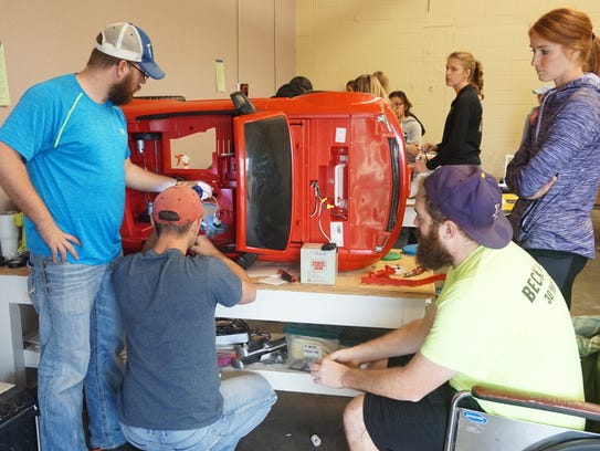 SBU DPT students discuss wiring options for a hand-activated