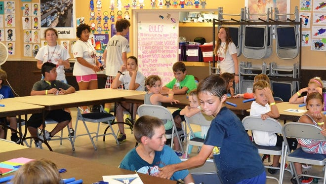 Camp Mackle campers create their own rockets during a Aerospace Education and Rocketry workshop last month.