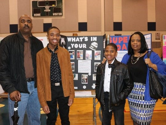 First place winner, Jaylen Ross (second from left) with father, Everette (left), brother, Jordon and mother, Michele.