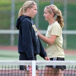 Delone Catholic's Alyssa Neudecker, left, talks to Ellie Neudecker during the YAIAA Class 2A doubles championship match earlier this month.